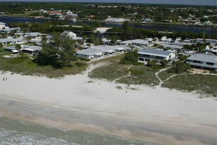 Property aerial showing beach