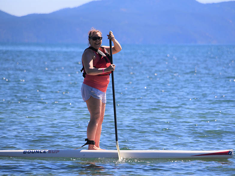 breast cancer survivor paddleboarding